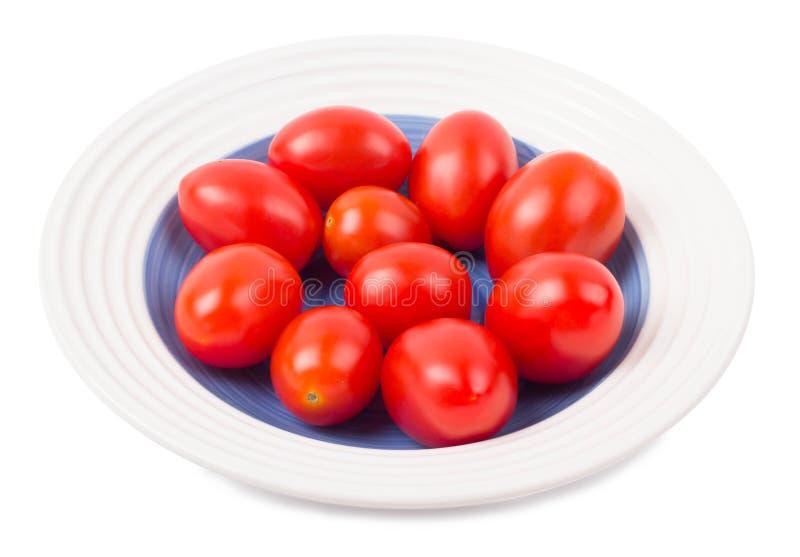Δαμάσκηνο ντοματών που διαμορφώνεται σε ένα πιάτο στοκ φωτογραφία