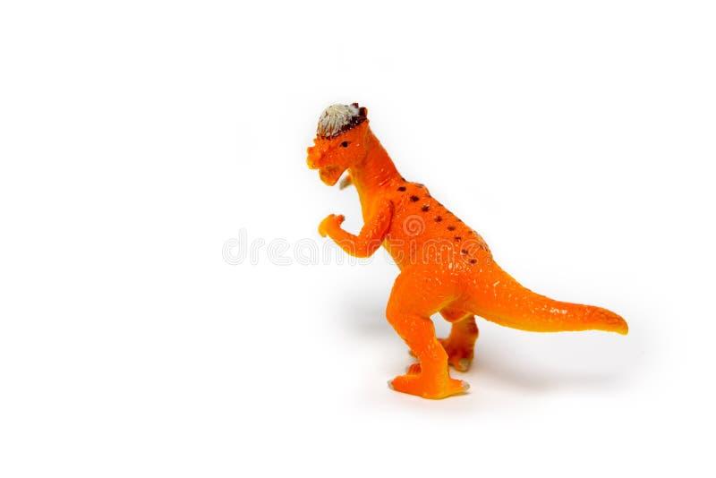 δεινόσαυροι παιχνιδιών σε ένα απομονωμένο άσπρο υπόβαθρο στοκ εικόνες
