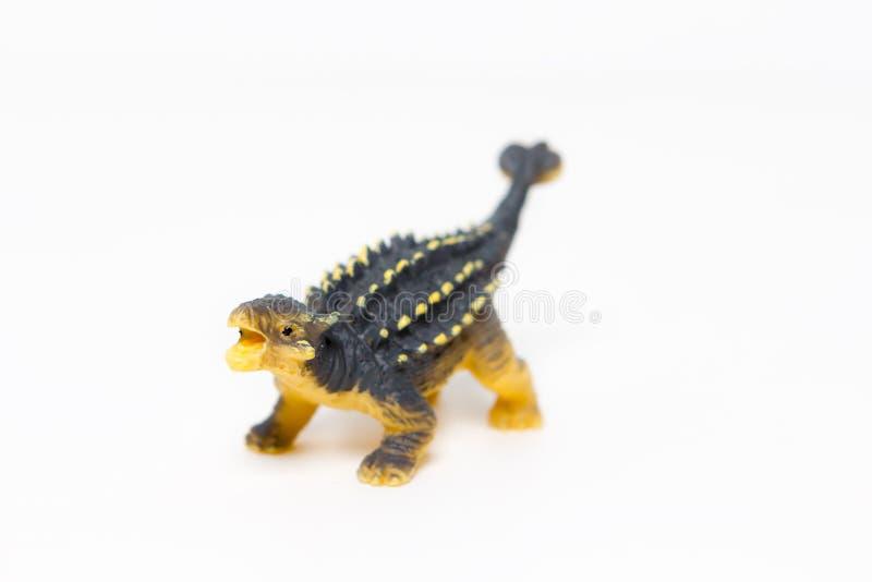 δεινόσαυροι παιχνιδιών σε ένα απομονωμένο άσπρο υπόβαθρο στοκ φωτογραφία