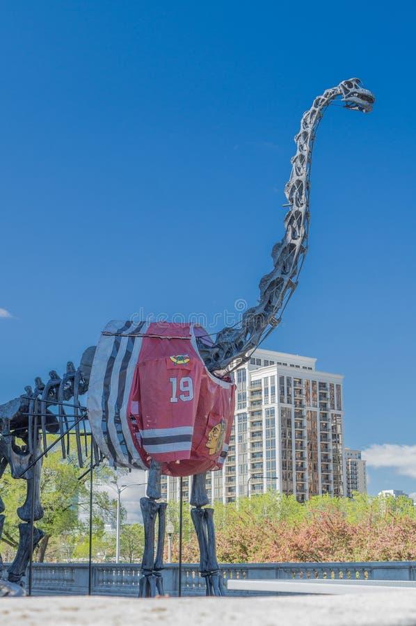 Δεινόσαυρος με το Τζέρσεϋ Blackhawks στοκ εικόνα με δικαίωμα ελεύθερης χρήσης