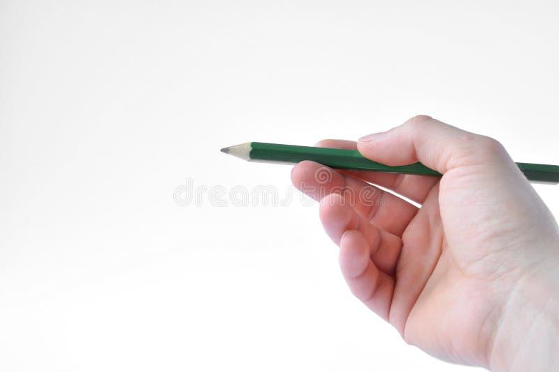 Δεξής με ένα πράσινο μολύβι στοκ φωτογραφίες