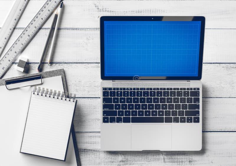 Δημιουργικός υπολογιστής γραφείου σχεδιαστών και αρχιτεκτόνων με τα στοιχεία lap-top και χαρτικών Χλεύη επάνω ελεύθερη απεικόνιση δικαιώματος