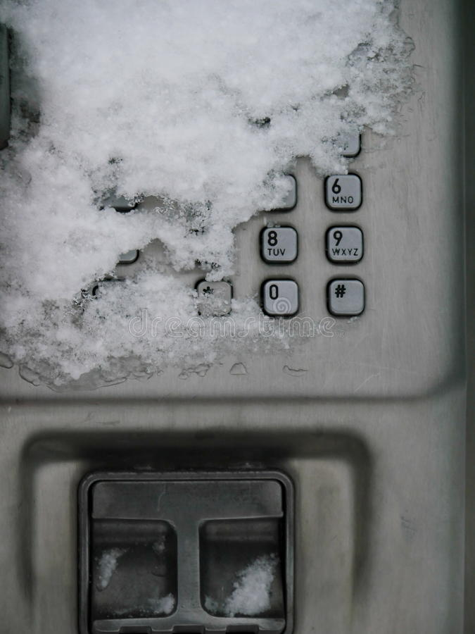 Δημόσιο τηλέφωνο χιονιού στοκ φωτογραφίες