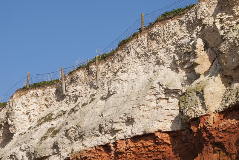 Διάβρωση των απότομων βράχων σε Hunstanton, Norfolk, UK. στοκ εικόνα