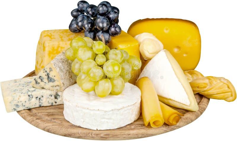 Διάφορα είδη τυριών και σταφυλιού στον ξύλινο στοκ φωτογραφία με δικαίωμα ελεύθερης χρήσης