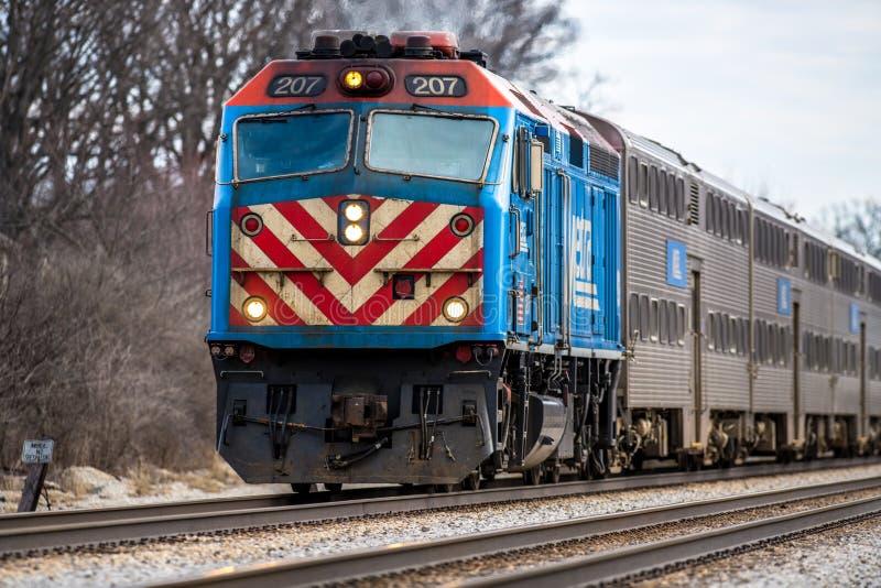 Διακινούμενη δύση αμαξοστοιχιών περιφερειακού σιδηροδρόμου Metra στοκ εικόνες με δικαίωμα ελεύθερης χρήσης