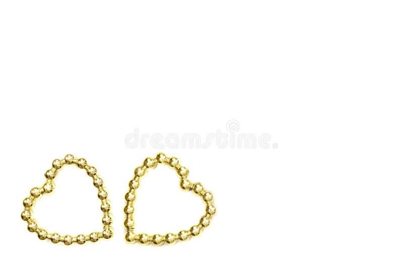 διακοσμητικές καρδιές βαλεντίνος ημέρας s Χρυσές καρδιές σε ένα άσπρο υπόβαθρο στοκ εικόνα με δικαίωμα ελεύθερης χρήσης
