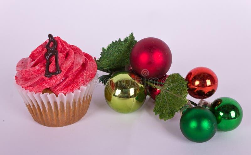 Διακόσμηση χριστουγεννιάτικων δέντρων και cupcake με το κερί στοκ εικόνες με δικαίωμα ελεύθερης χρήσης