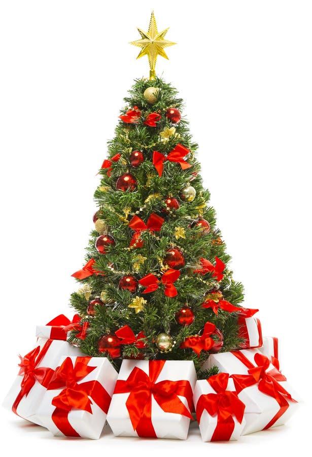 Διακόσμηση χριστουγεννιάτικων δέντρων με τα παρόντα κιβώτια δώρων, χριστουγεννιάτικο δέντρο στοκ εικόνες