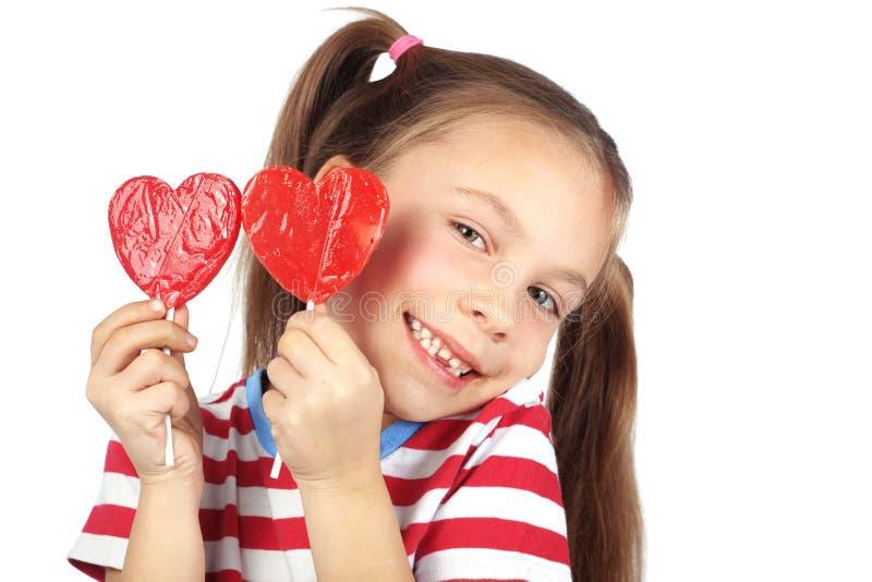 Διαμορφωμένη καρδιά καραμέλα εκμετάλλευσης παιδιών στοκ φωτογραφίες με δικαίωμα ελεύθερης χρήσης