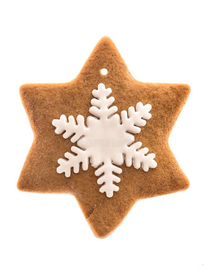 Διαμορφωμένο αστέρι μπισκότο μελοψωμάτων με snowflake τήξης στοκ εικόνα