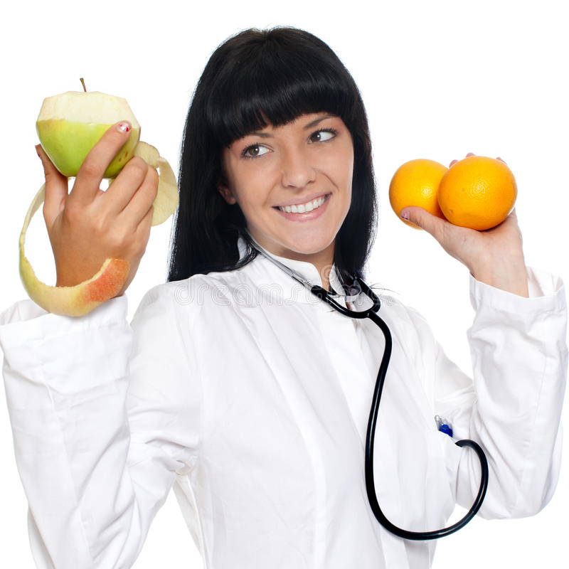 Διατροφολόγος γιατρών με τα φρούτα στοκ εικόνες