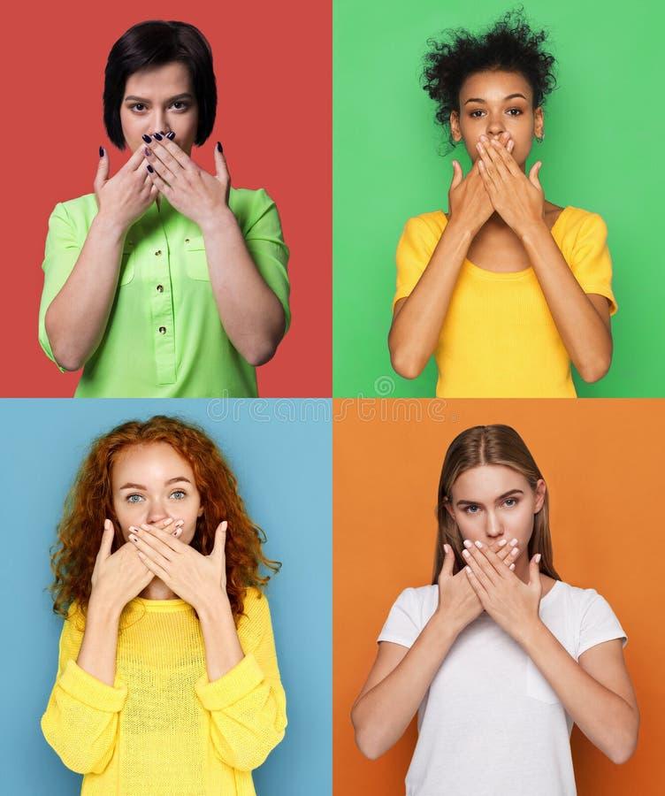Διαφορετικές νέες γυναίκες που καλύπτουν το στόμα με τα χέρια στοκ εικόνες
