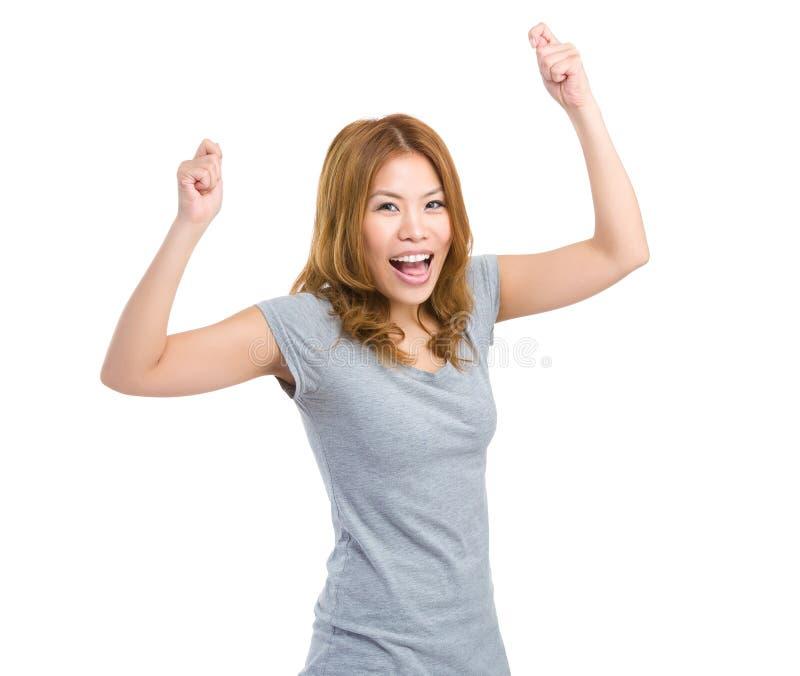 Διεγείρετε τη γυναίκα αυξάνει το χέρι επάνω στοκ εικόνες