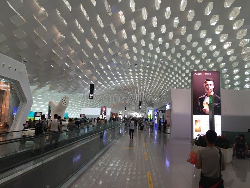 Διεθνείς άνθρωποι πινάκων διαφημίσεων αερολιμένων Baoan Shenzhen στοκ φωτογραφίες με δικαίωμα ελεύθερης χρήσης