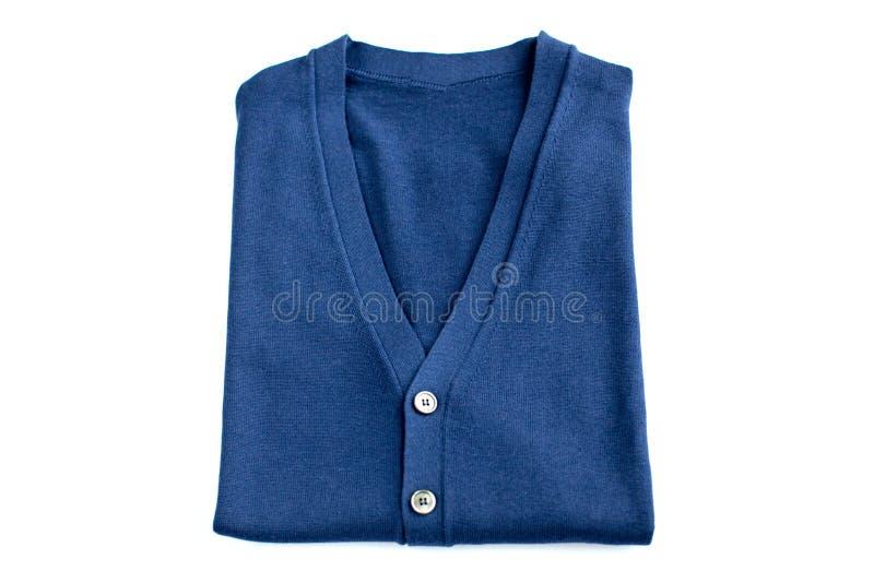 Διπλωμένο μπλε πουλόβερ που απομονώνεται στο άσπρο υπόβαθρο στοκ φωτογραφίες