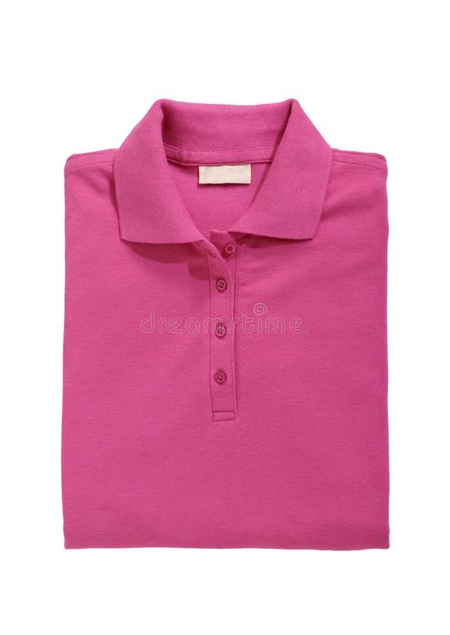 Διπλωμένο ροζ πουκάμισων πόλο που απομονώνεται στο λευκό στοκ εικόνες