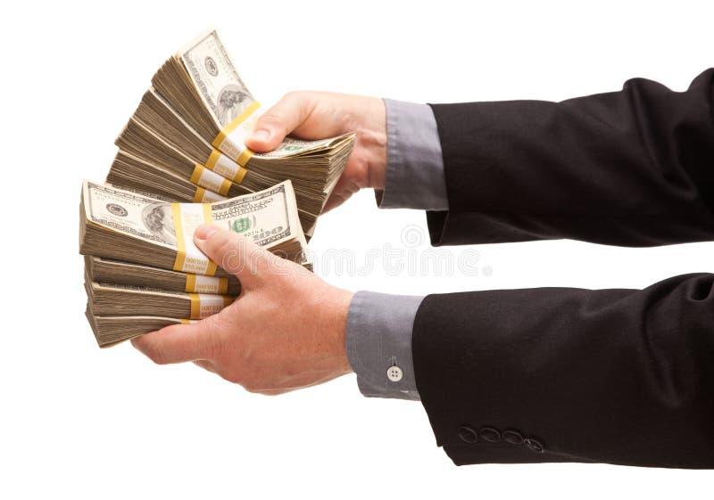 δολάρια που δίνουν το άτ&omicro στοκ εικόνες
