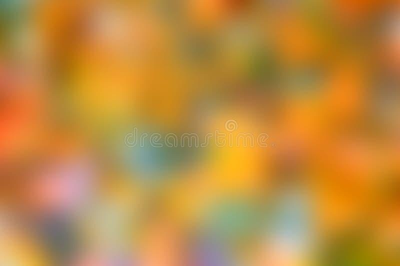 Δονούμενο θολωμένο υπόβαθρο των πράσινων, πορτοκαλιών και πράσινων χρωμάτων στοκ εικόνες