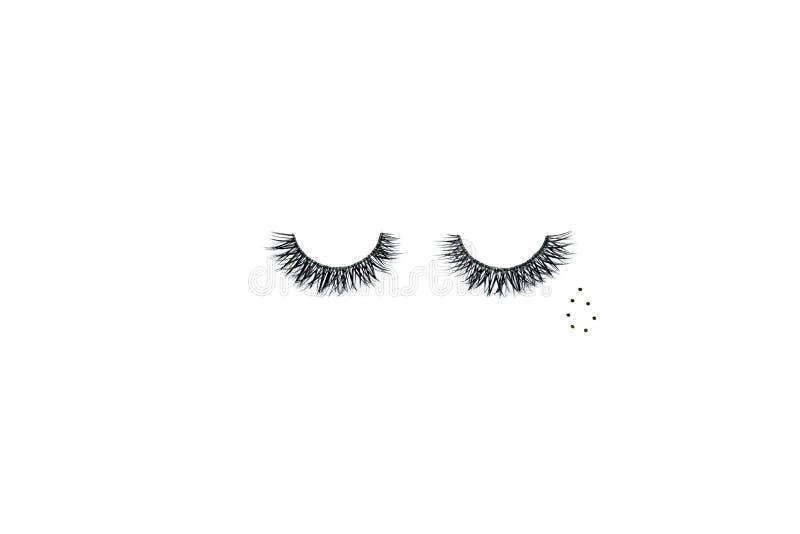 Δραματικά μαύρα μακροχρόνια ψεύτικα eyelashes που τοποθετούνται με μορφή ενός βόμβου στοκ φωτογραφίες