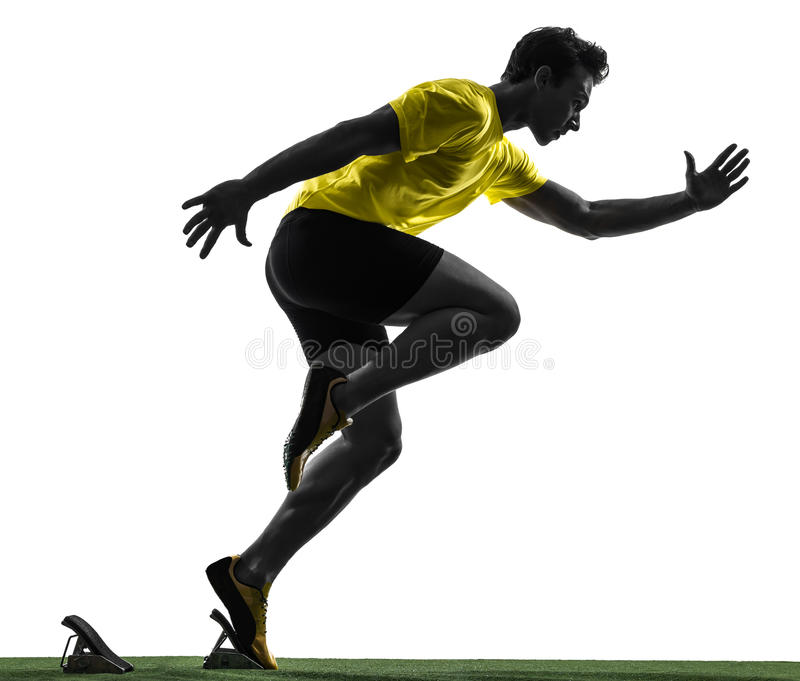 Δρομέας νεαρών άνδρων sprinter στην αρχική σκιαγραφία φραγμών στοκ φωτογραφία