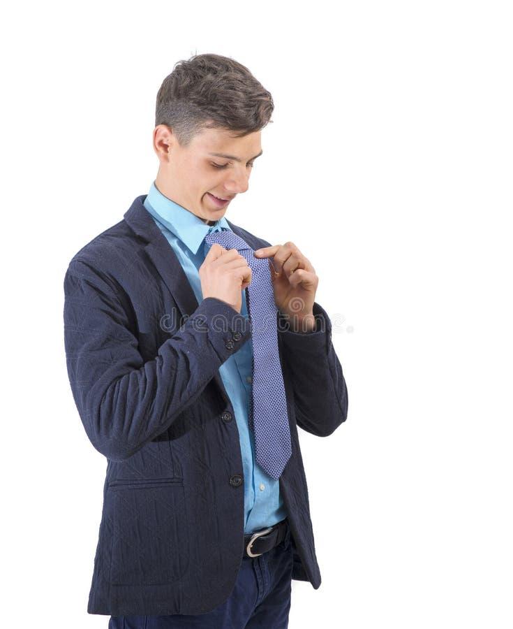 Δροσερό έξυπνο αγόρι που δεσμεύει το δεσμό του στοκ φωτογραφίες με δικαίωμα ελεύθερης χρήσης