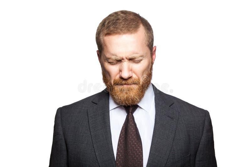 Δυστυχισμένος λυπημένος επιχειρηματίας με τις ιδιαίτερες προσοχές στοκ εικόνα με δικαίωμα ελεύθερης χρήσης