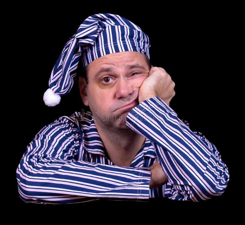 Δυστυχισμένο άτομο στις πυτζάμες στοκ φωτογραφία με δικαίωμα ελεύθερης χρήσης