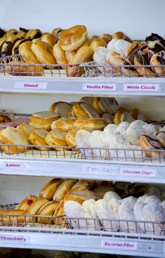 Δωδεκάδες των donuts στοκ φωτογραφία