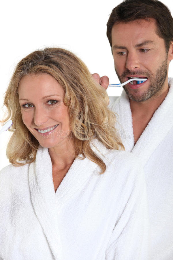 Download Δόντια βουρτσίσματος ζεύγους Στοκ Εικόνα - εικόνα από φθορά, πρόσωπο: 22777113