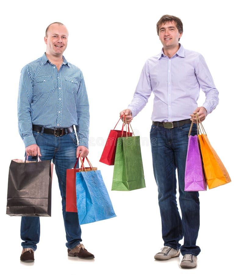 Δύο άτομα με τις τσάντες αγορών στοκ εικόνες