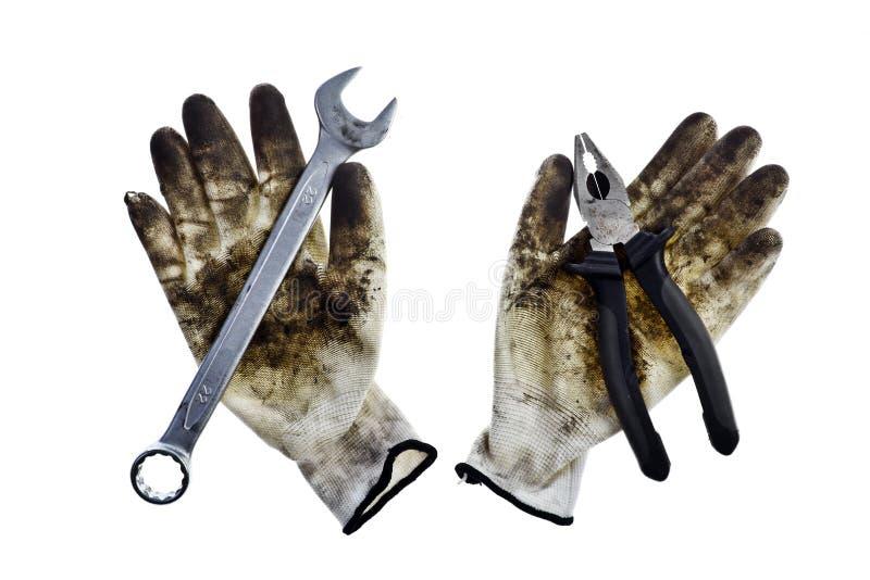 Γαλλικό κλειδί, πένσες και ένα γάντι στοκ εικόνες