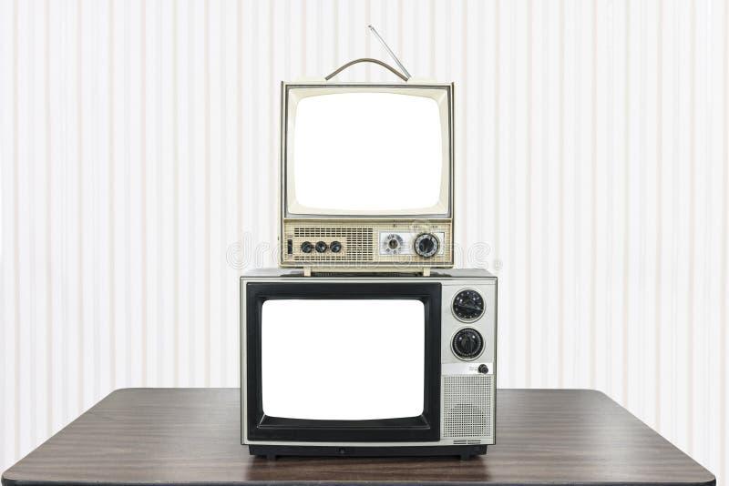 Δύο εκλεκτής ποιότητας τηλεοράσεις με τις αποκόπτως οθόνες στοκ εικόνες