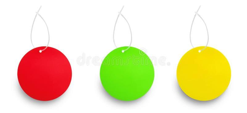 Δύο κρεμώντας ετικέττες χρώματος ενάντια στο λευκό στοκ εικόνες με δικαίωμα ελεύθερης χρήσης
