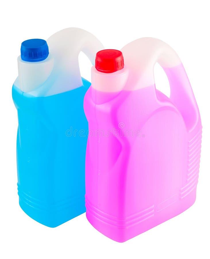 Δύο μεταλλικά κουτιά με τις υγρές χημικές ουσίες στοκ εικόνα