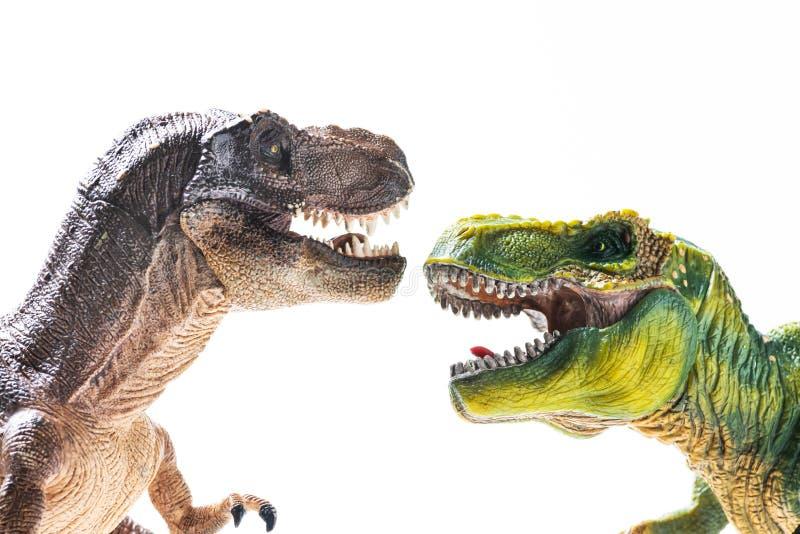 Δύο πλαστικά ειδώλια τ -τ-rex στοκ εικόνες