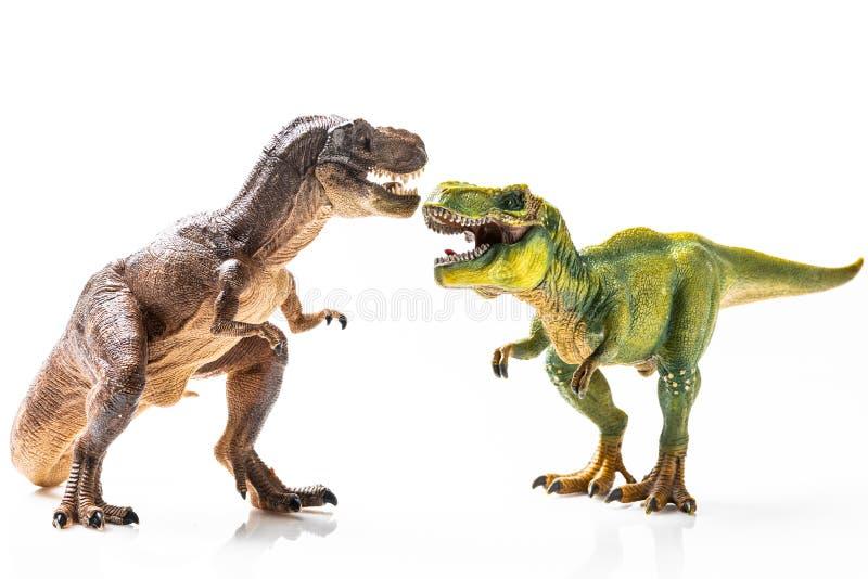Δύο πλαστικά ειδώλια τ -τ-rex στοκ φωτογραφίες