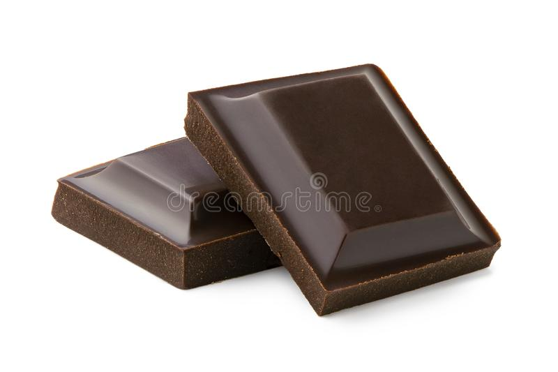 Δύο τετράγωνα της σκοτεινής σοκολάτας που απομονώνονται στο λευκό στοκ εικόνες