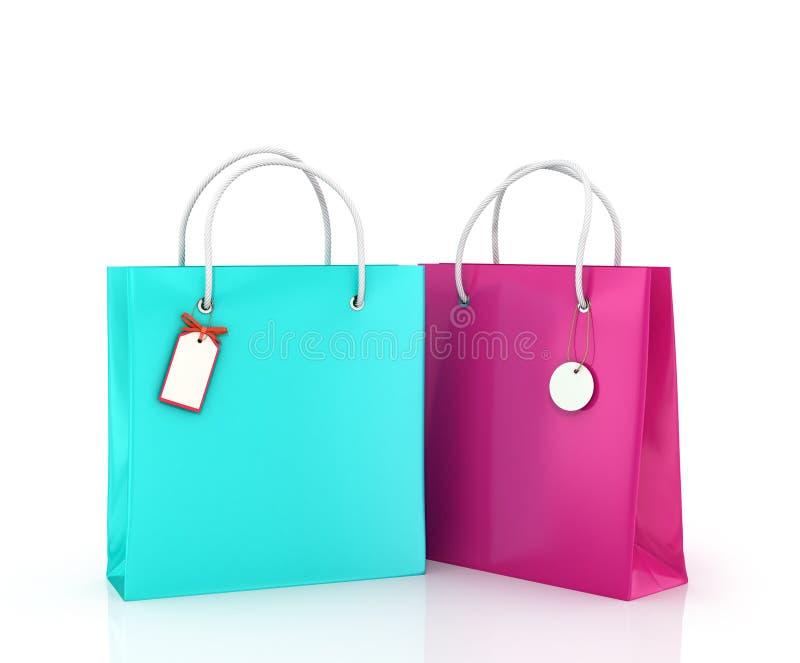 Δύο τσάντες χρώματος με τις ετικέττες στοκ φωτογραφία