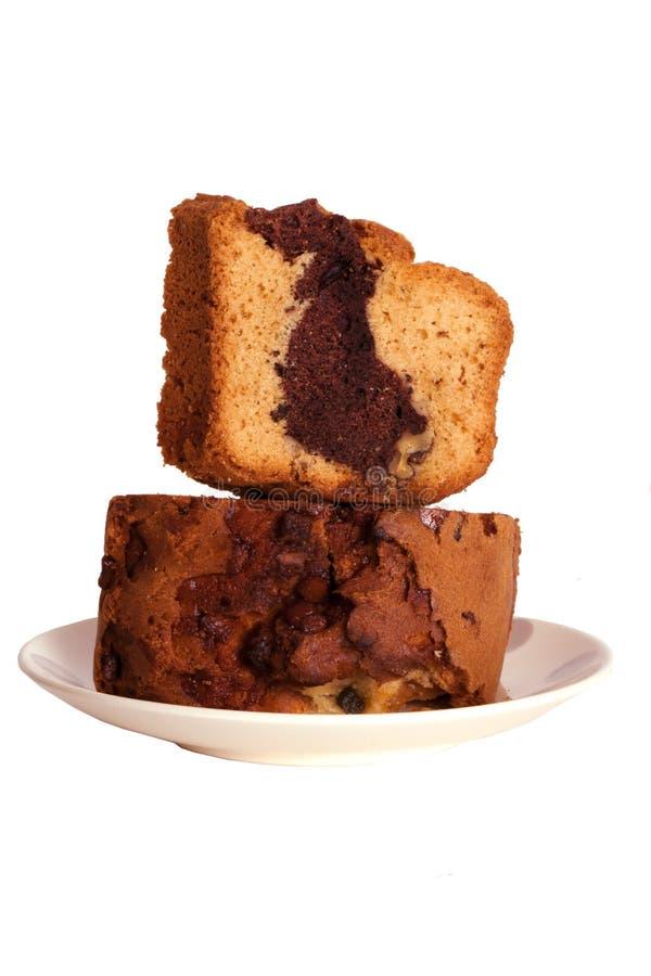 Δύο φέτες του κέικ κρέμας σοκολάτας σε ένα πιάτο στοκ φωτογραφία με δικαίωμα ελεύθερης χρήσης