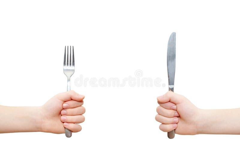 Δύο χέρια που κρατούν το δίκρανο και το μαχαίρι στοκ εικόνες με δικαίωμα ελεύθερης χρήσης