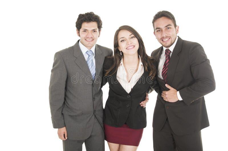 Δύο όμορφοι επιχειρηματίες και μια επιχειρηματίας μέσα στοκ εικόνα
