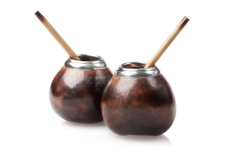 Δύο calabashes με τα bombillas που απομονώνονται στο λευκό στοκ εικόνα