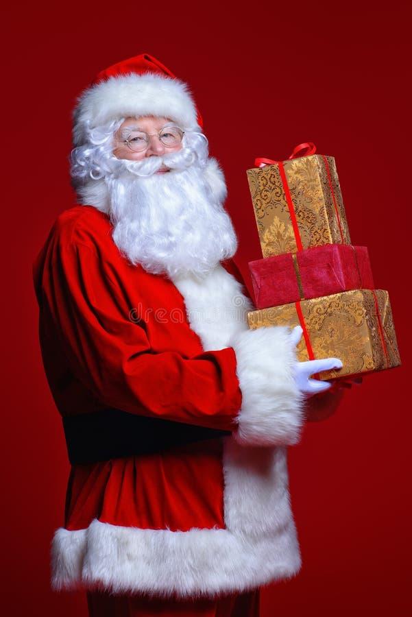 Δώρα εκμετάλλευσης Santa στοκ εικόνες