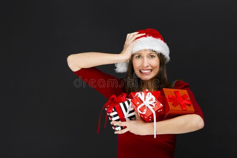 Δώρα Χριστουγέννων εκμετάλλευσης γυναικών στοκ φωτογραφίες