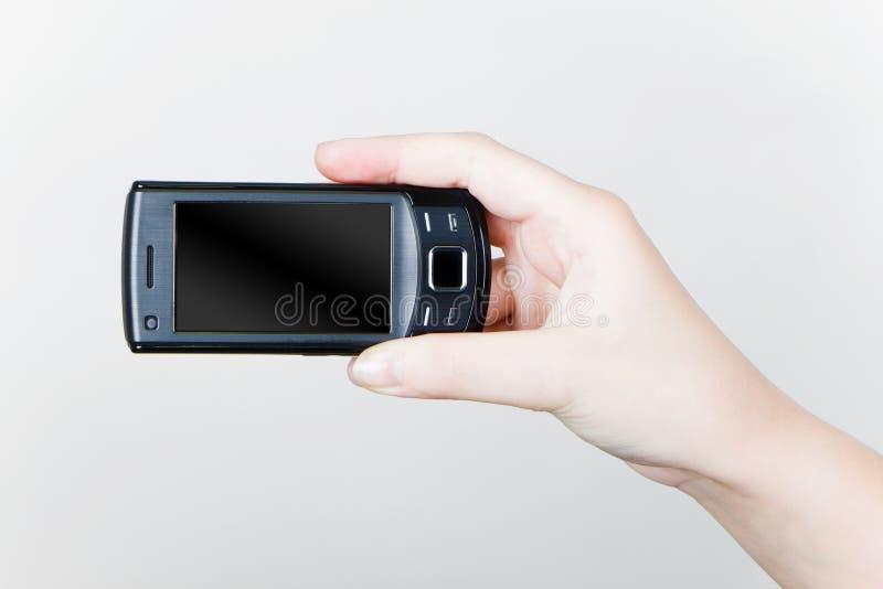δώστε το κινητό τηλέφωνό το&upsi στοκ εικόνα