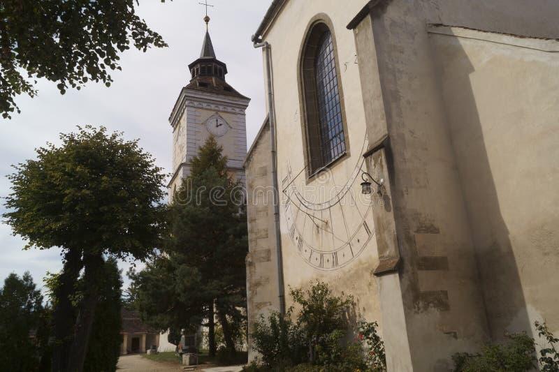 Εβαγγελικός-λουθηρανική εκκλησία ST Bartholomew και ηλιακό ρολόι Biserica Sfantul Bartolomeu, Brasov, Ρουμανία στοκ φωτογραφία