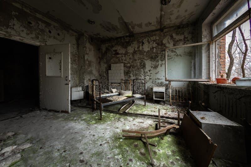 Εγκαταλειμμένο δωμάτιο νοσοκομείων σε Pripyat, ζώνη 2019 του Τσέρνομπιλ Excusion στοκ φωτογραφίες με δικαίωμα ελεύθερης χρήσης