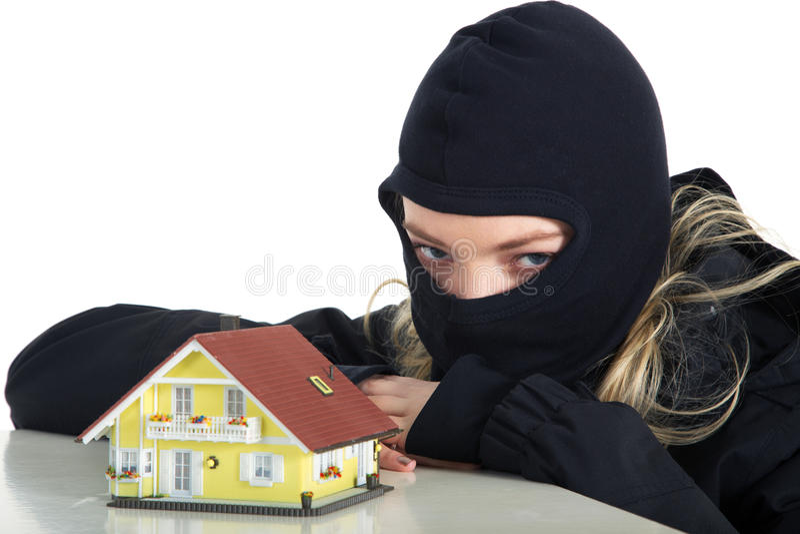 Εγκληματικός διαρρήκτης σχεδίων στο σπίτι στοκ εικόνες