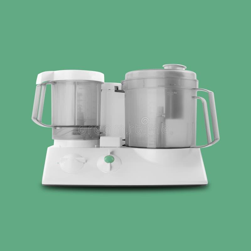 Εγχώρια συσκευή - απομονωμένο επεξεργαστής πράσινο υπόβαθρο τροφίμων στοκ εικόνες